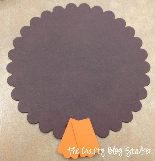 gluing the feet onto a brown scallop circle