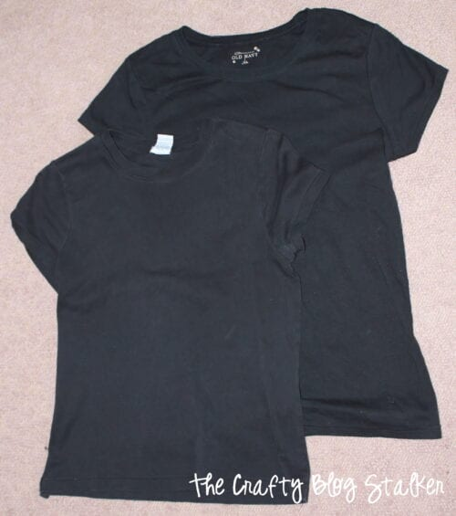 two black shirts purchased from a second hand store