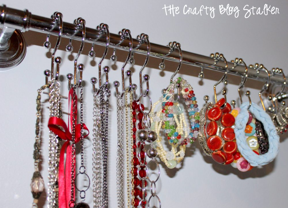 Organize your jewelry on a towel bar and shower hooks. It is the perfect Jewelry Hanger. Necklaces are tangle free and you can easily find your favorites.