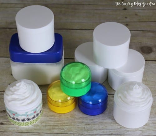 several different containers storing the homemade body lotion for winter