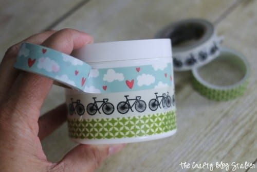 decorating a jar of Homemade Lotion with washi tape