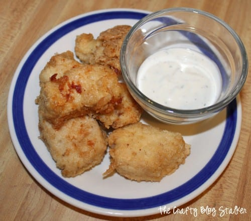 a plate of homemade chicken nuggets with a side of homemade ranch