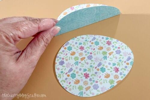 folding the paper eggs along the score line