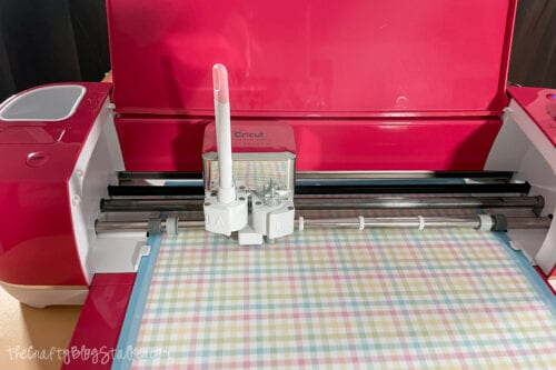 cricut Explore Air 2 cutting out the banner pieces