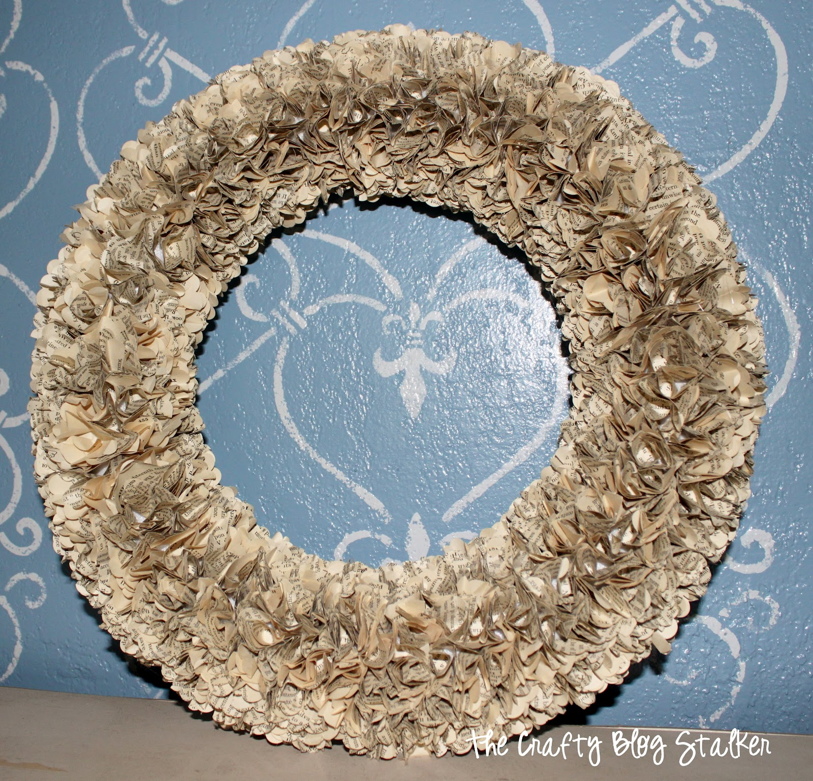 Make your own beautiful paper wreath using pages from a vintage book. It makes a beautiful home decor piece that you can display all year long.