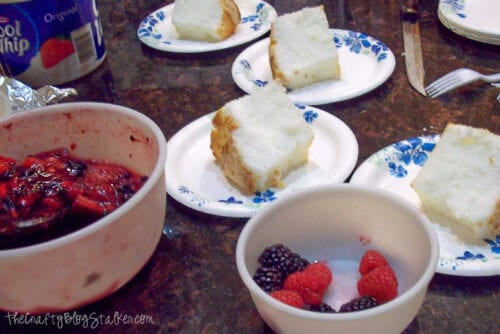 angel food cake with mixed berry sauce