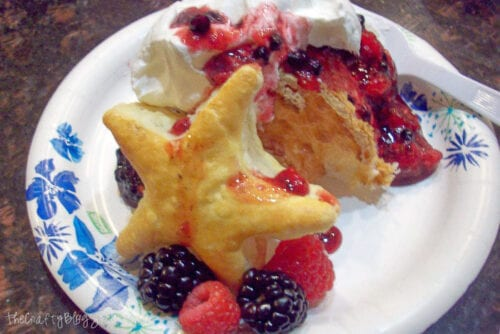mixed berry patriotic dessert on a paper plate