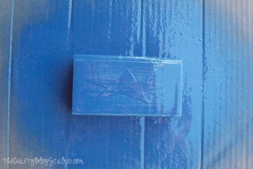 a block of wood spray painted blue