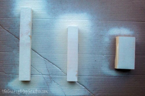 pieces of wood spray painted white