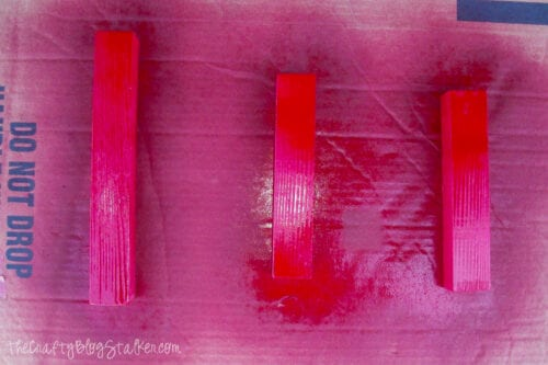 pieces of wood spray painted red