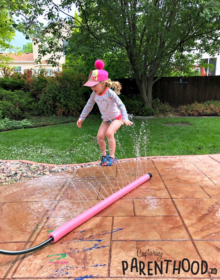 image of a girl jumping in a Pool Noodle Sprinkler