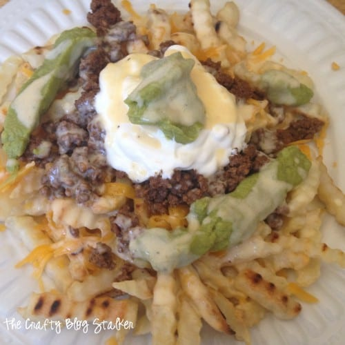 How to Make Delicious Taco Meat Loaded Fries featured by top US craft blog, The Crafty Blog Stalker