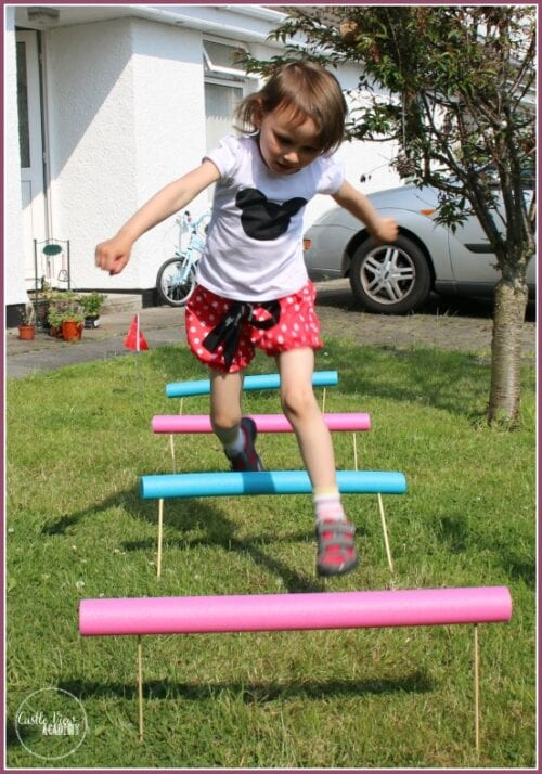image of a girl jumping over Pool Noodle Hurdles