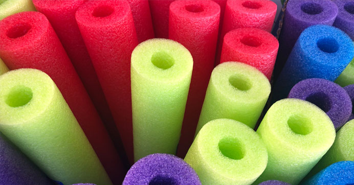 image of red, green, blue and purple pool noodles