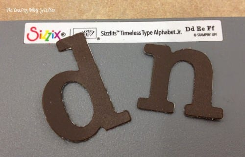 image of sizzlits letters D and N cut out of cardstock with a Big Shot