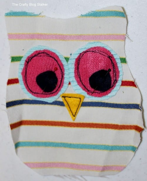 image of sewed on eyes and beak to the owl stuffie