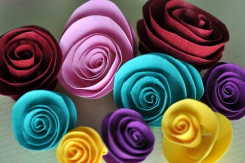 red, pink, yellow, purple and blue rolled paper flowers
