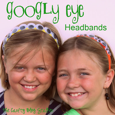 two girls wearing headbands with googly eyes