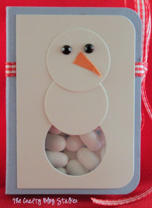 Tic Tac Snowman Kisses are a fun party favor for your holiday party. Easy DIY craft tutorial idea that makes a great Christmas teacher gift.