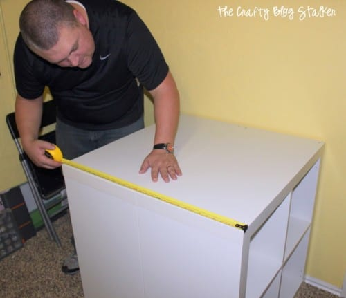 How to make a custom craft table using Ikea Kallax shelves and a tabletop. This is a DIY table that you can make for your craft room. An easy DIY craft tutorial idea.