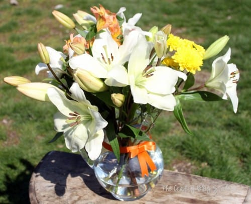 simple mixed flower lily bouquet on a wooden table