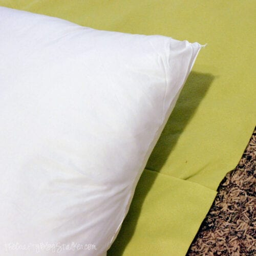 a pillow placed on top of the fleece fabric
