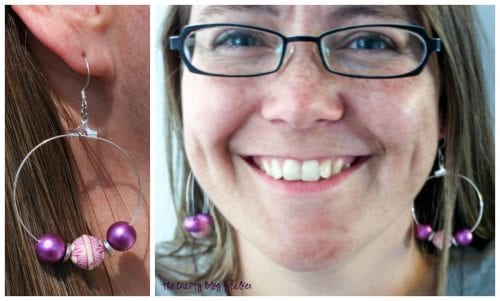 image of finished large beaded earrings being worn by a woman