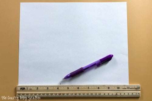image of creating a pattern with a pen, ruler, and piece of paper