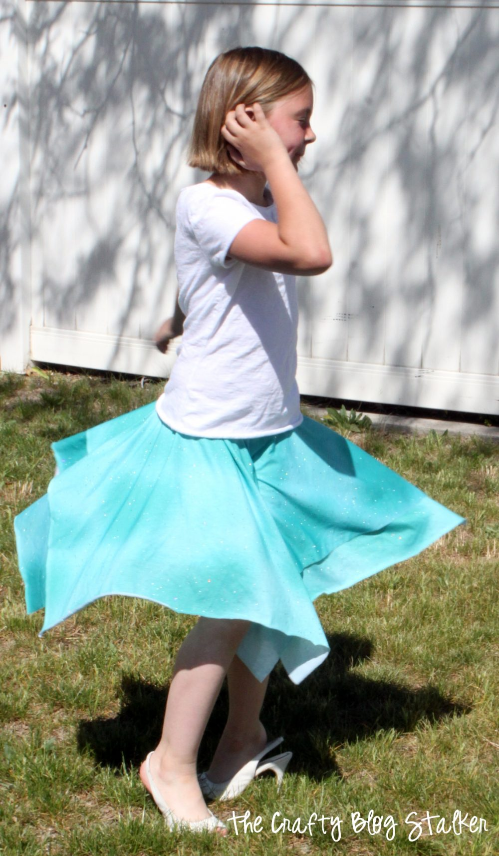 image of a girl twirling wearing her layered square circle skirt