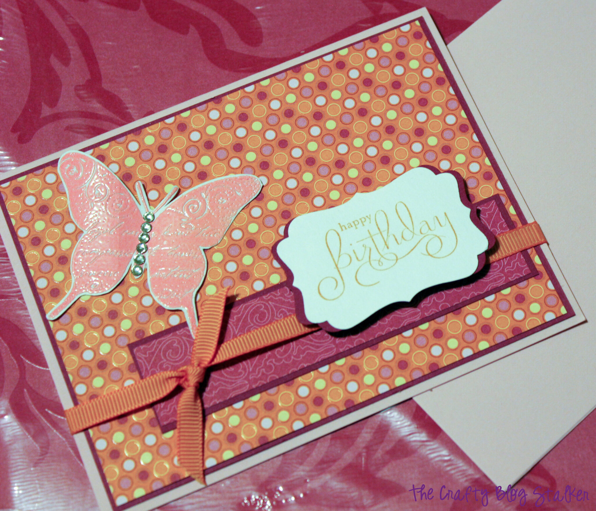 image of the finished handmade card with an embossed butterfly