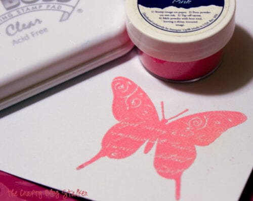 image of a stamped butterfly covered with pink embossing powder