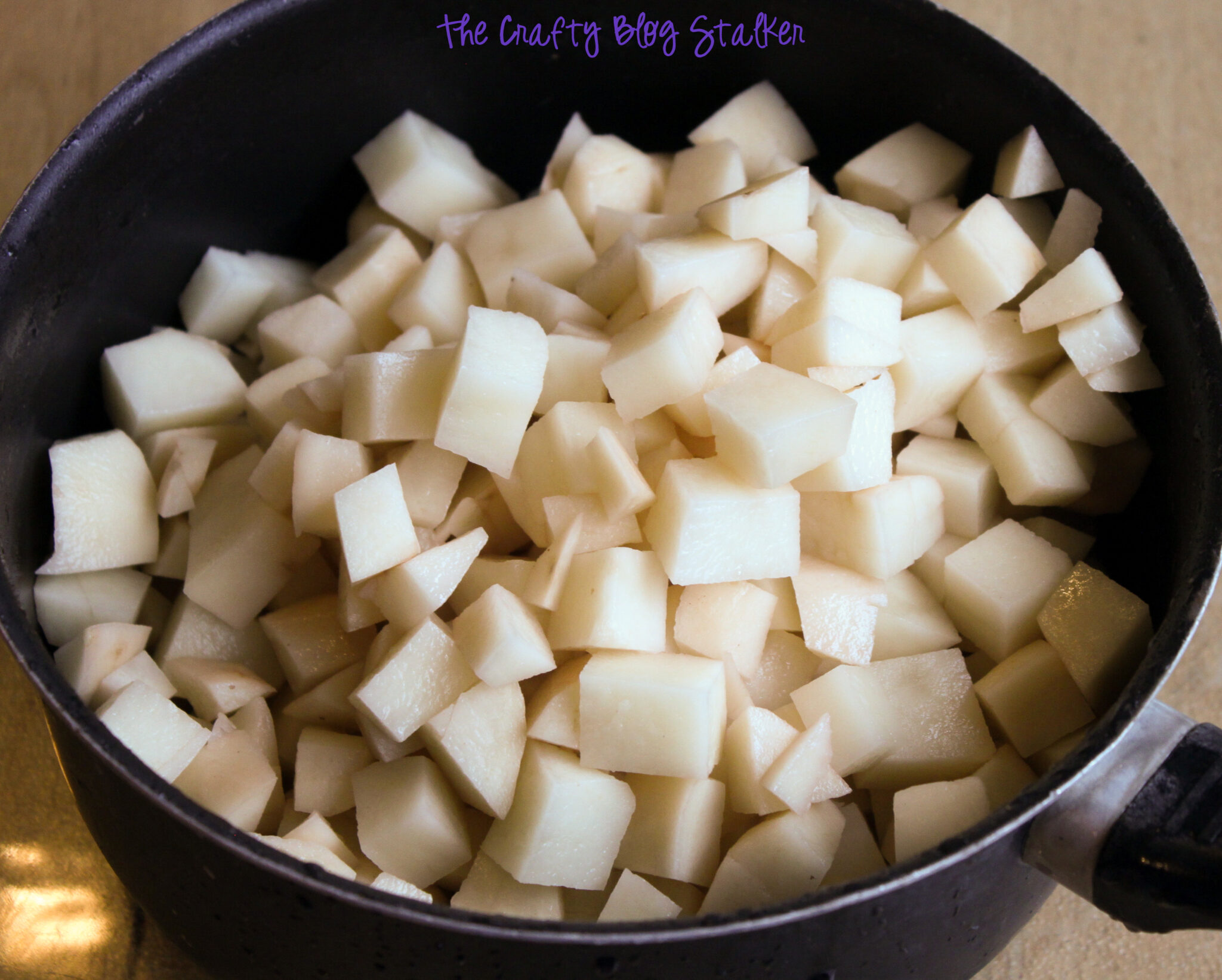image of diced potatoes in a saucepan