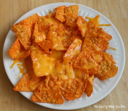 image of melted shredded cheese on a plate of doritos