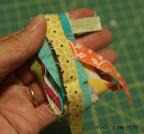 wrapping fabric straps around four fingers