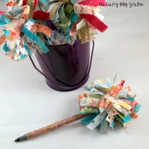 fabric pom pom pen next to a purple bucket