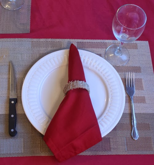 table setting with red napkin