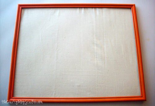 orange painted frame with a muslin backing