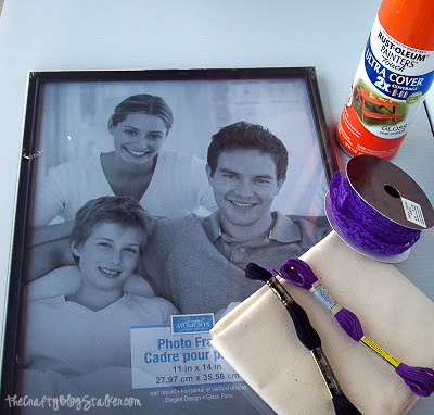 dollar store frame, orange spray paint, purple lace, embroidery floss and muslin fabric
