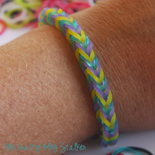 a fishtail bracelet on a wrist