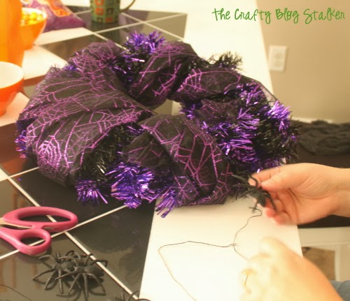 Have a Halloween decorating party! Get together with friends and come up with different easy DIY craft Halloween wreath ideas.