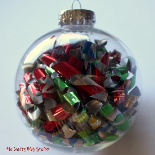 Make a keepsake ornament with aluminum soda cans. An easy DIY craft tutorial idea for ball ornaments will look great hanging on your Christmas Tree.