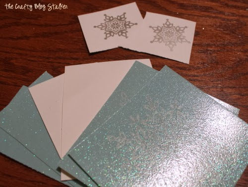 How to Make a Paper Snowflake Christmas Ornament, a tutorial featured by top US craft blog, The Crafty Blog Stalker.