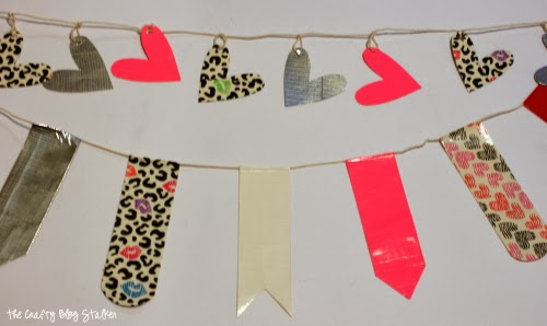 Create a Heart Banner using rolls of Duck Tape. Fun kids crafts that can also be used as party decor! An easy DIY craft tutorial idea.