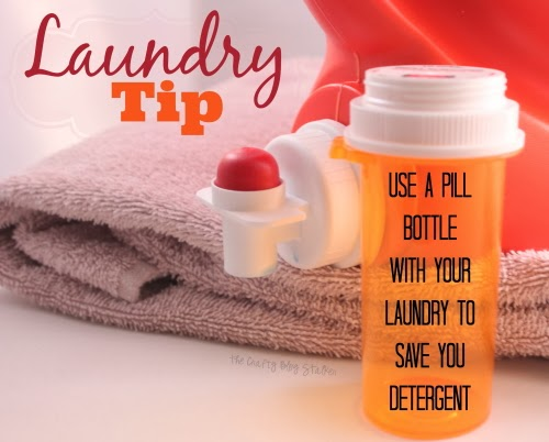 an empty pill bottle in front of a bottle of laundry detergent on a towel - tips for the home