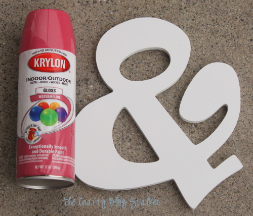 ampersand sign and pink spray paint