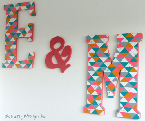 the finished monograms hanging on the wall