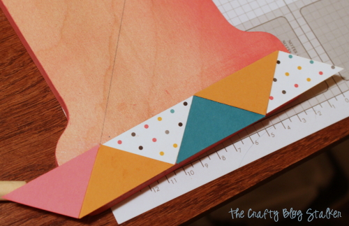 applying rows of triangles to the monogram wood base