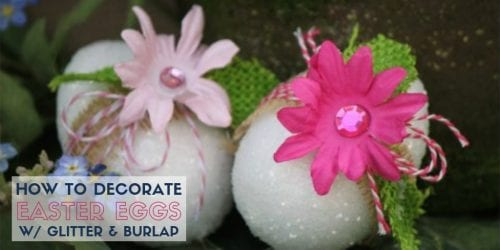 two finished decor easter eggs with pink artificial flowers, twine, and burlap