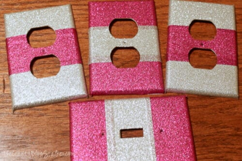 several decorated covers with duck tape