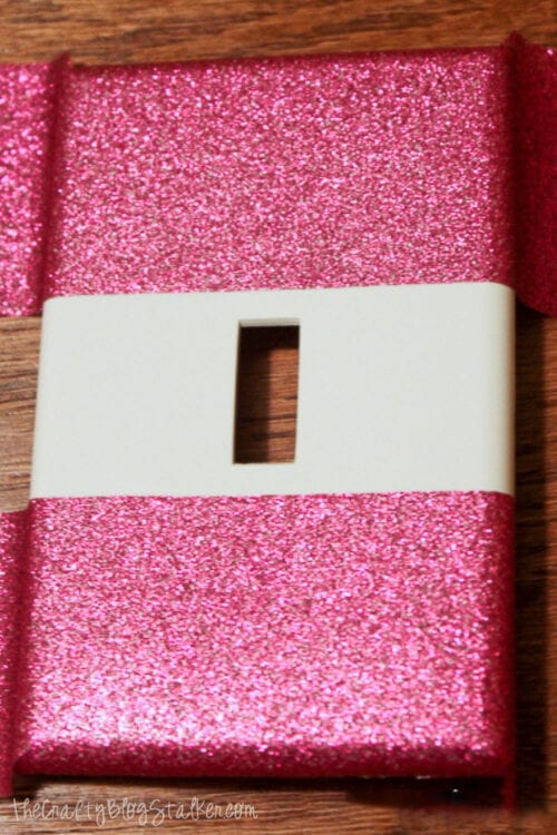 switch plate with two strips of duck tape
